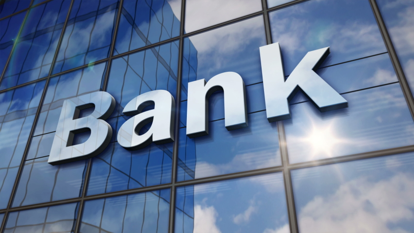 Bank sign on glass building. Mirrored sky and city on modern facade. Business and finance concept in 3D rendering animation. Royalty-Free Stock Footage #1037948840