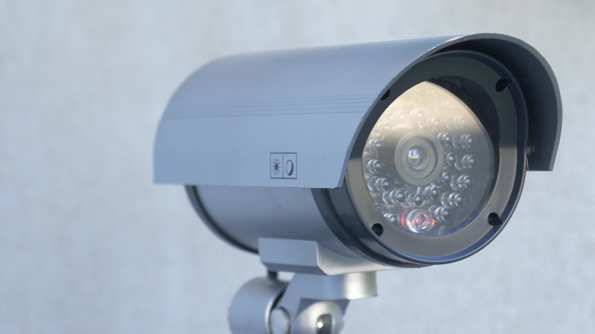 Security video camera moving to scan the area for surveillance purposes. Robotic CCTV recording technology. Royalty-Free Stock Footage #1037988374
