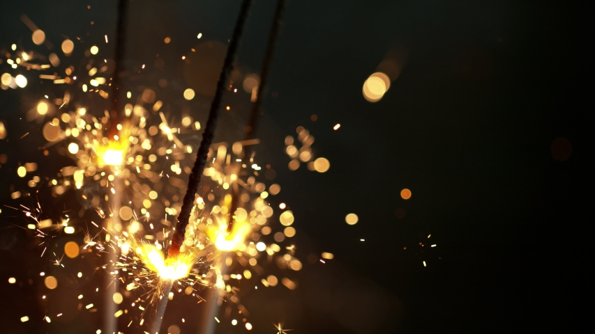 Super slow motion of burning sparklers on black background. Filmed on high speed cinema camera, 1000fps. | Shutterstock HD Video #1038006449