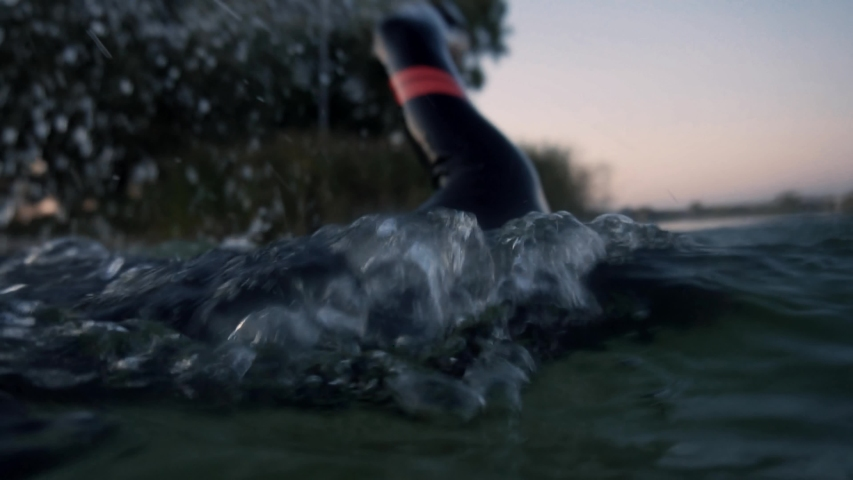 Triathlete Swimming On Lake.Triathlete Workout Swim Preparing To Triathlon Competition.Professional Swimmer Sport Training For Triathlon Competition In Open Water.Swimmer Crawl Exercising Underwater   Shutterstock HD Video #1038021926