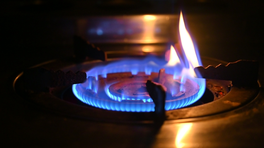 Burn burner. Gas is switching on, apearing blue flame gas stove video 4K | Shutterstock HD Video #1038039524