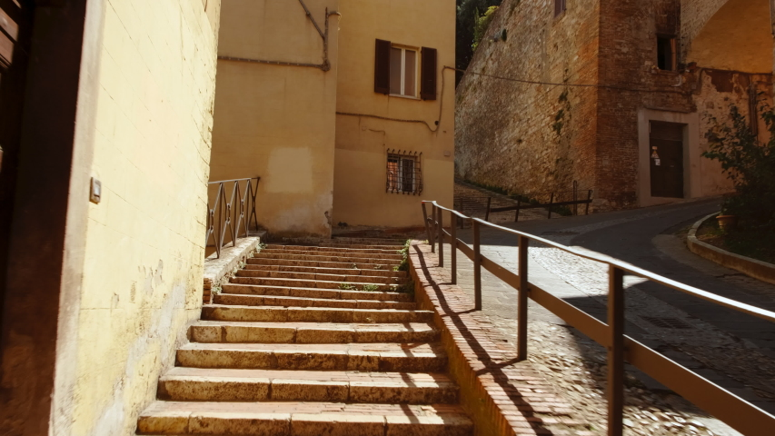 Walking along the historic center of Perugia, Umbria, Italy. The city built a reputation for its universities and chocolates Royalty-Free Stock Footage #1038075734