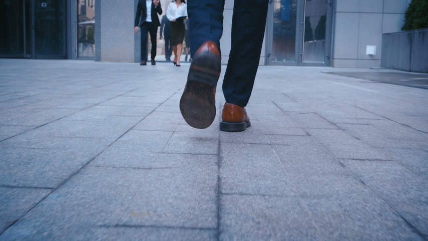 Rear back view feet of Business man commuting to work. Confident guy in suit being on his way to office building | Shutterstock HD Video #1038082817
