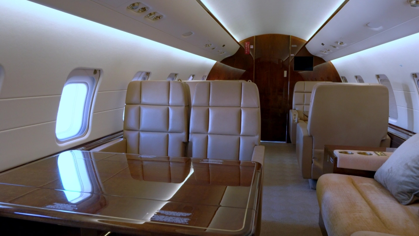 Modern private business jet leather seats and interior | Shutterstock HD Video #1038086768