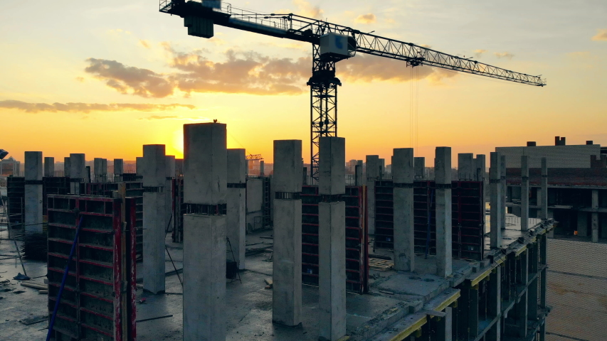 Project site with crane and high-rise buildings at sunset | Shutterstock HD Video #1038087377