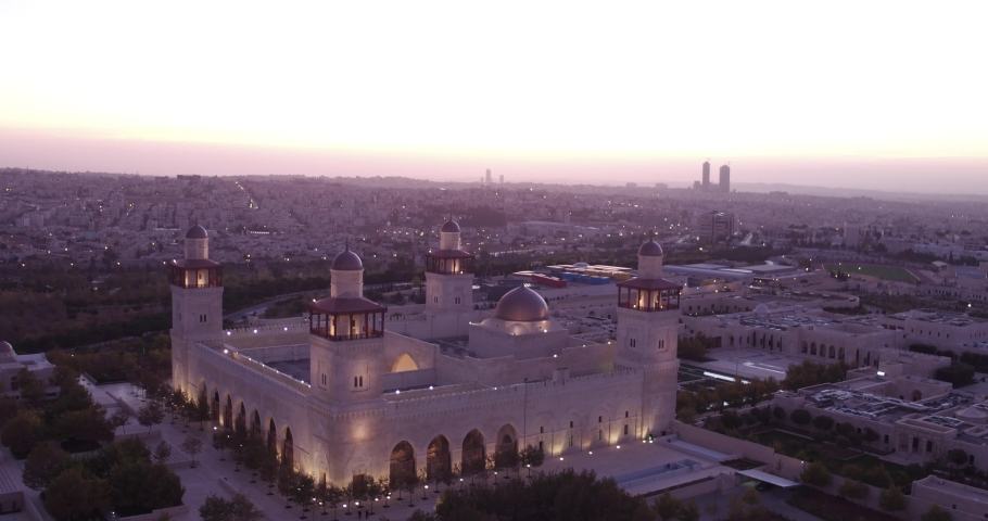 AMMAN, JORDAN - CIRCA 2019 - beautiful aerial shot at dusk of the Islamic mosque in downtown Amman, Jordan.
