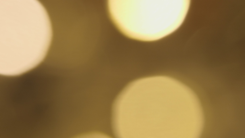 Warm pulsating christmas party lights with bokeh effect on black bacgrkound | Shutterstock HD Video #1038130937