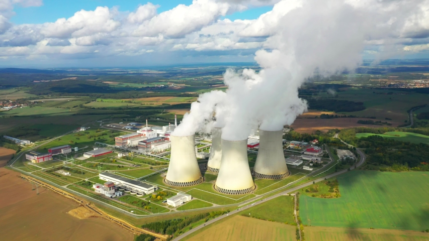 Aerial view to nuclear power plant. Atomic power stations are very important sources of electricity with low carbon footprint. Industrial emissions and ecology in 21th century.