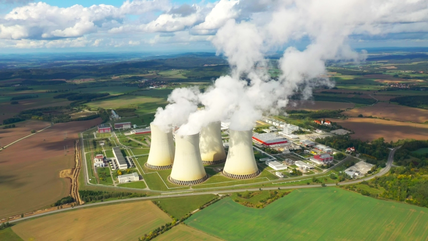 Aerial view to nuclear power plant. Atomic power stations are very important sources of electricity with low carbon footprint. Industrial emissions and ecology in 21th century. Royalty-Free Stock Footage #1038132551