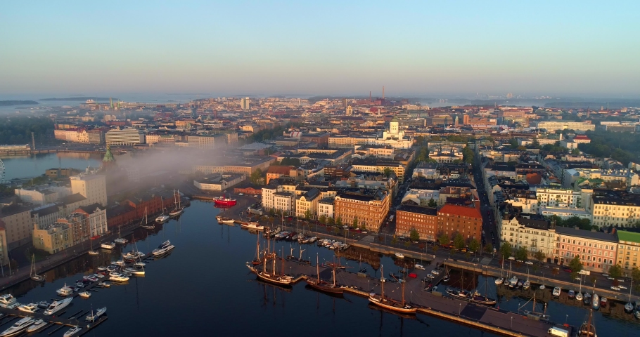 Helsinki north harbor, Aerial, tracking, drone shot, towards the cityscape and the cathedral, at sunrise, on a foggy, morning dawn, in Helsingfors, Uusimaa, Finland | Shutterstock HD Video #1038172217