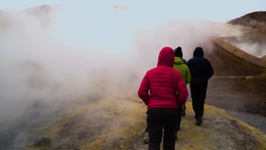 Tourists walk through steam that rises from hot springs. Kerlingarfjoll geotermal area, Iceland. | Shutterstock HD Video #1038201497
