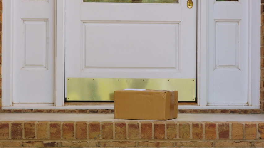 Man opening front door and picking up package delivered to the doorstep. Retrieving shipment parcel box from porch of house. Royalty-Free Stock Footage #1038204197