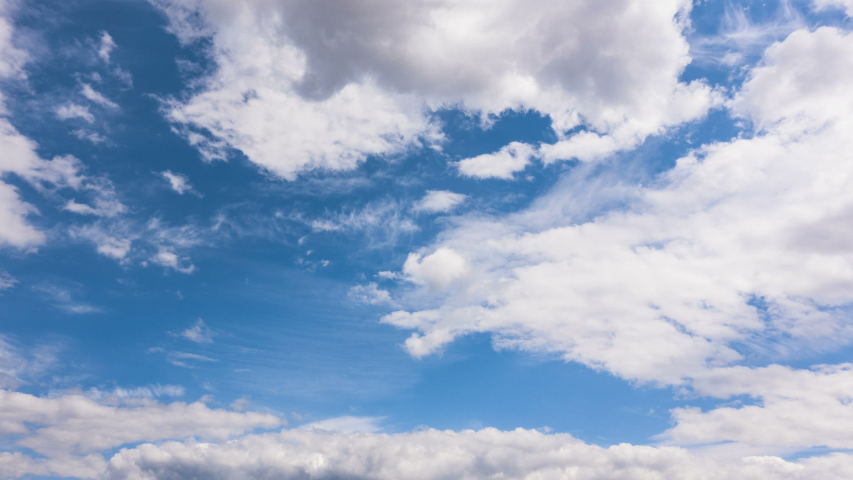 Time lapse clouds, rolling puffy cloud are moving, white lightness clouds time lapse. Cloud running across the blue sky.4k Timelapse of white clouds with blue sky in background. | Shutterstock HD Video #1038219575