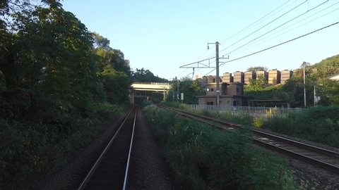 Akita, Japan - May 22, 2019: Rural scenery with the rail track at summer day in Akita, Japan.
