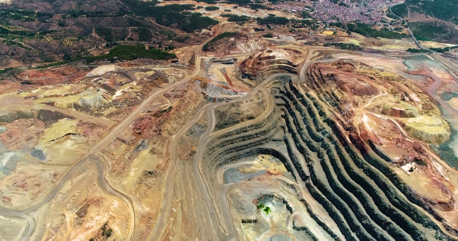 Open pit mine in the Rio Tinto in Spain in aerial view, ore extraction
