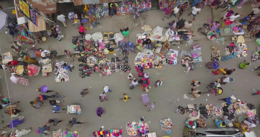 LAGOS, NIGERIA- MAY 16 2019 4K BIRDS EYE VIEW OF A CROWDED MARKET IN LAGOS NIGERIA. AERIAL SHOT OF A CROWDED STREET IN LAGOS, WHERE BUYING AND SELLING TAKES PLACE TRADERS ARE SELLING GOODS