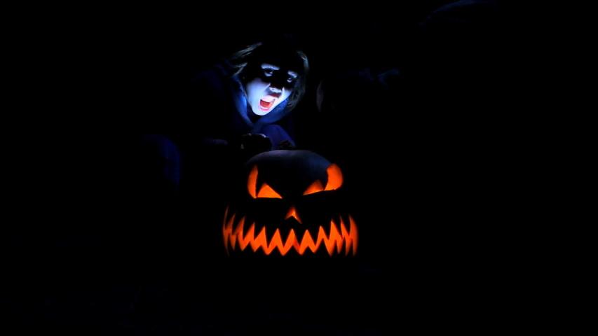 Carved Halloween pumpkin lights inside. Slow motion effect. | Shutterstock HD Video #1038300752