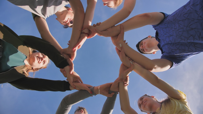 Partnership and unity concept: people holding wrists of each other   Shutterstock HD Video #1038300848