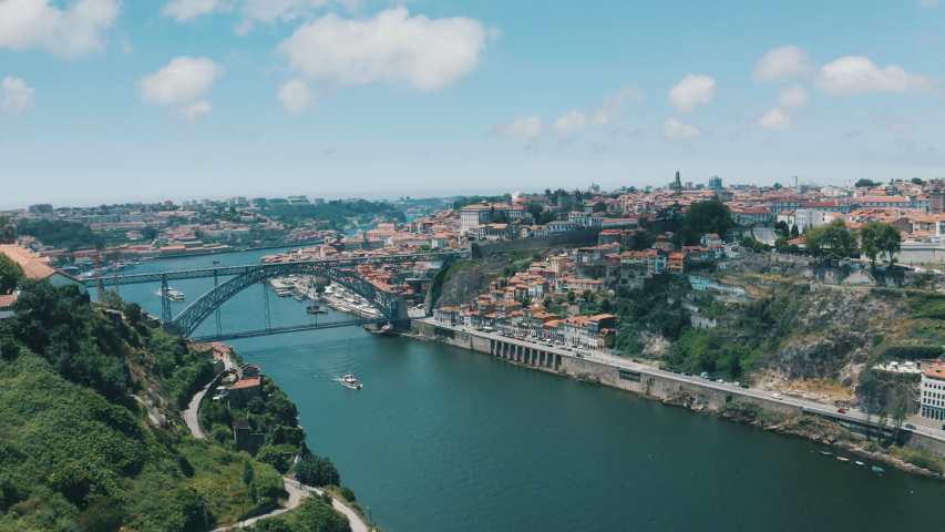 4K Porto Aerial Ponte Dom Luís I bridge on Douro river in sunny Portugal | Shutterstock HD Video #1038314606