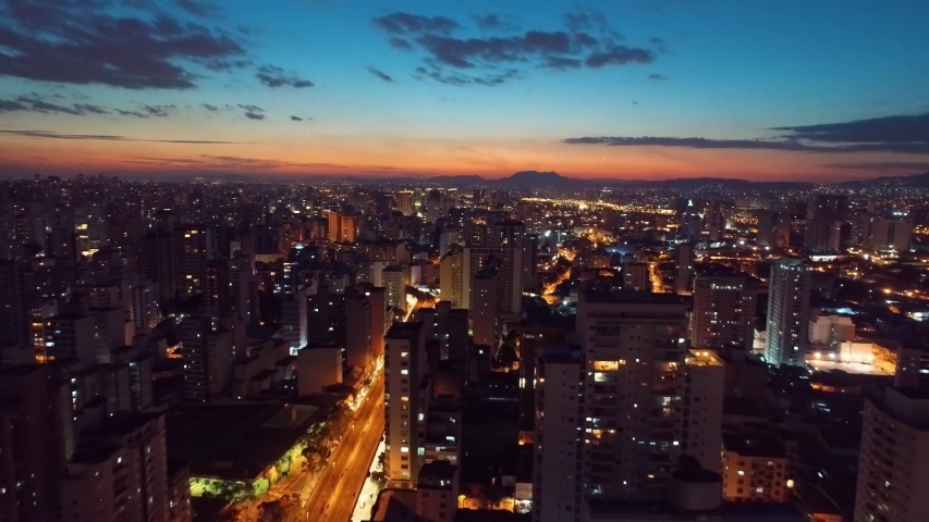 Aerial view of sunset in the quarantined city with empty streets due Covid-19. São Paulo, Brazil.  | Shutterstock HD Video #1038332378