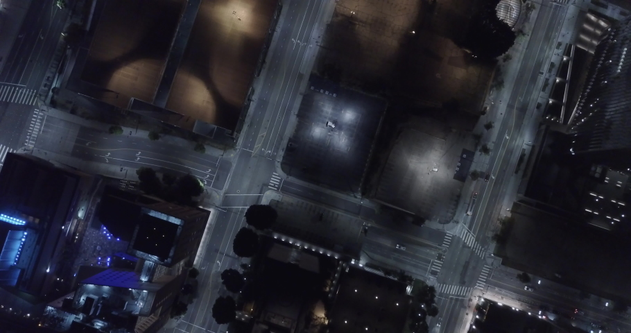 Cinematic Birds-Eye Aerial of downtown intersection at night - Los Angeles - 4K | Shutterstock HD Video #1038335783