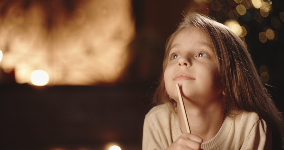 Sweet caucasian child is writing a letter to santa claus in room, decorated for christmas, preparing for holiday -christmas spirit, holidays and celebrations concept close up 4k footage | Shutterstock HD Video #1038340484
