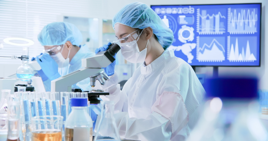 asian scientist team has researching in the laboratory Royalty-Free Stock Footage #1038347696