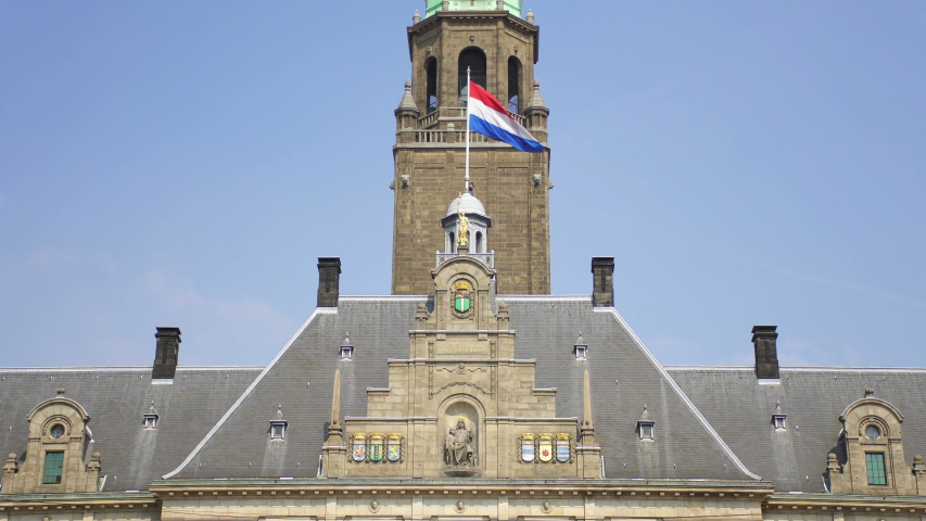 Rotterdam's City Hall facade and Netherlands flag waving in the wind | Shutterstock HD Video #1038350360