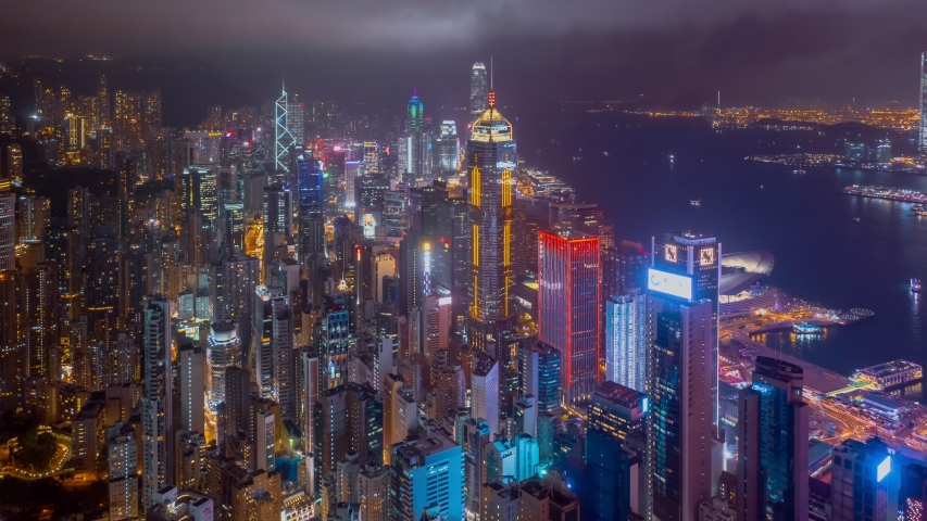 Hong Kong, China 8 July 2019:Aerial drone hyper lapse or time lapse over Hong Kong at night. Central distinct of Hong Kong shot by 4K resolution drone, Victoria Harbor, Hong Kong financial center.