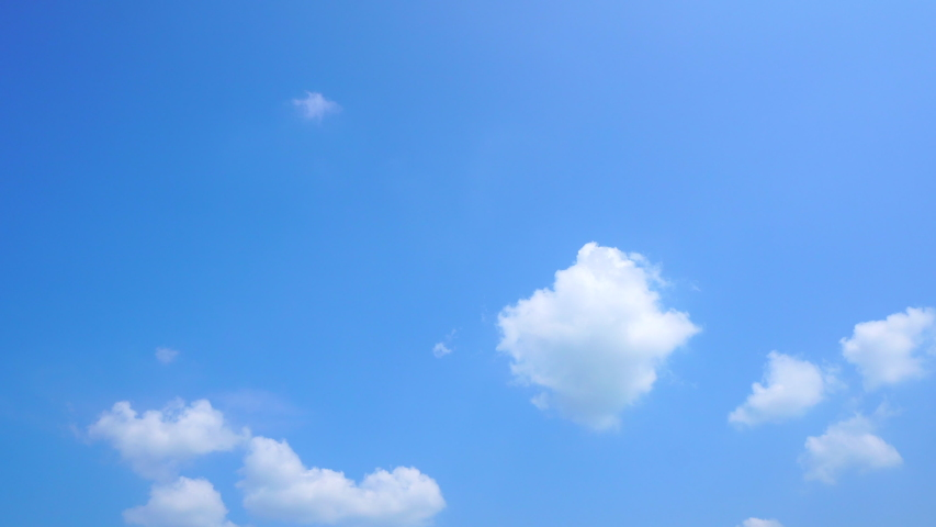 Time Lapse , Aerosol of white clouds In the light blue sky In the afternoon of the day for background or wallpaper    Shutterstock HD Video #1038365375