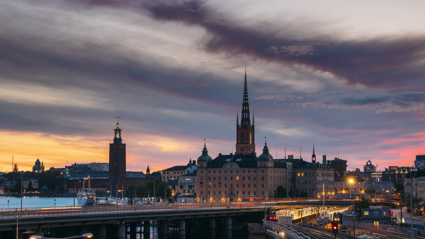 Stockholm, Sweden. Scenic View Of Stockholm Skyline At Summer Evening. Famous Popular Destination Scenic Place In Sunset Lights. Riddarholm Church, Subway Railway. Day To Night Transition Time Lapse | Shutterstock HD Video #1038375884