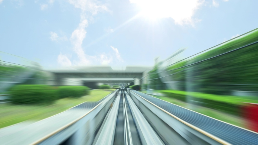 Future city transportation. An autonomous monorail train tracks and fast moving train in speed motion blur zoom effect | Shutterstock HD Video #1038378353