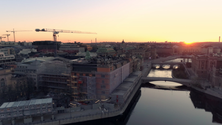 Aerial drone shot of Stockholm city and construction site at sunrise | Shutterstock HD Video #1038378956