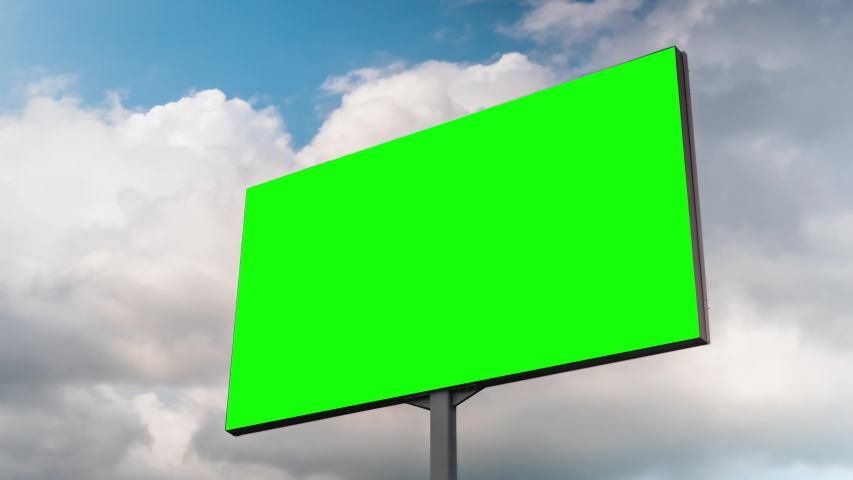 Timelapse - blank green billboard or large advertising display and moving white clouds against blue sky. Consumerism, chroma key, time lapse, green screen, template, mock up, copy space, concept | Shutterstock HD Video #1038380714