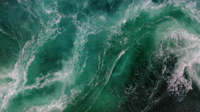 Waves of water of the river and the sea meet each other during high tide and low tide. Whirlpools of the maelstrom of Saltstraumen, Nordland, Norway Royalty-Free Stock Footage #1038388943
