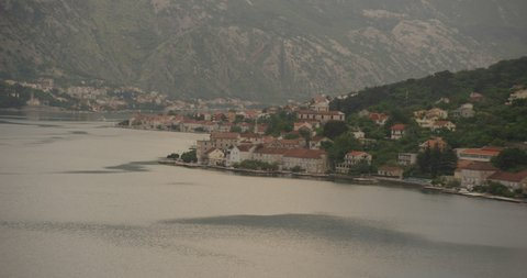 Helicopter aerial of Montenegro coastline residences at sunset