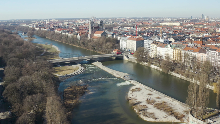 High view over the Reichenbachbridge and St Maximilian Church in Isar, Munich, Germany. Aerial drone footage flying forwards | Shutterstock HD Video #1038390662