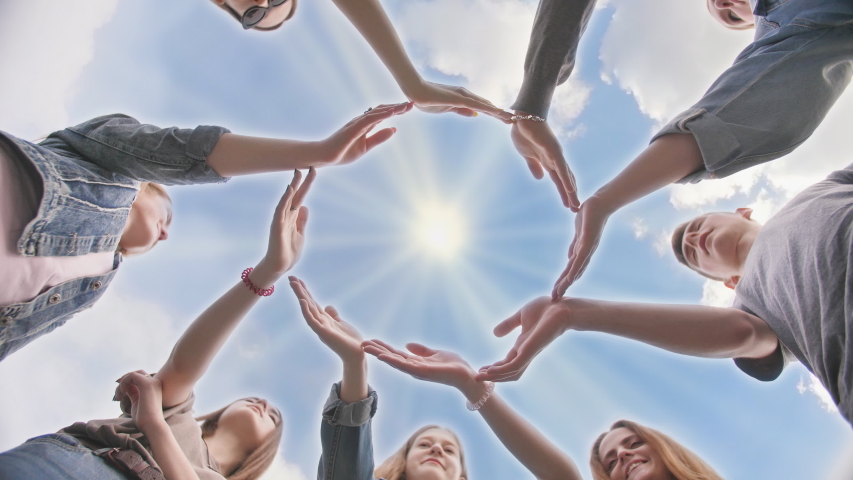 Conceptual symbol of cooperation diverse hands making a circle. Students help each other.   Shutterstock HD Video #1038399131