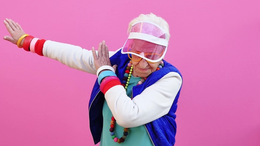 Funny grandmother portraits. 80s style outfit. Dab dance on colored backgrounds. Concept about seniority and old people