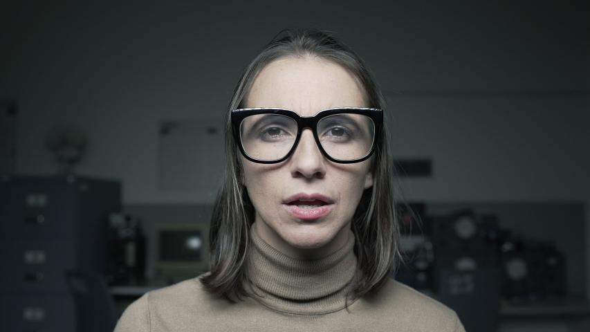 Woman staring at the computer screen and adjusting glasses, she has eyesight problems, point of view shot | Shutterstock HD Video #1038419747