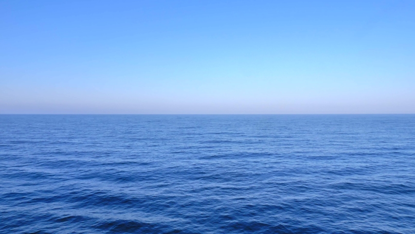 Deep Blue calm Ocean water with blue sky in the horizon, Early morning shot. #1038420371