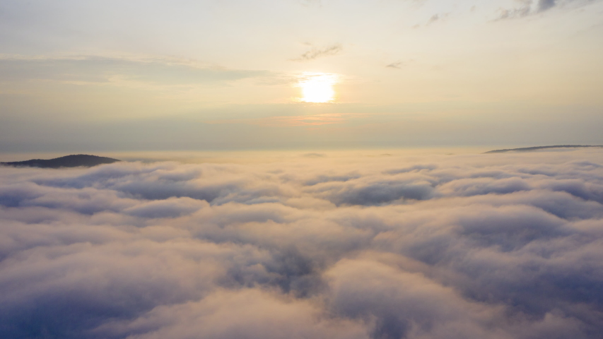 Aerial View. Flying in fog.Flight above clouds    Shutterstock HD Video #1038432872