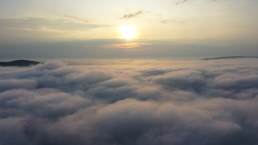 Aerial View. Flying in fog.Flight above clouds    Shutterstock HD Video #1038434918