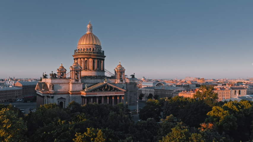 Summer morning view of Saint Isaac's Cathedral and threes of Alexander Garden in St.Petersburg and cultural center of city, Russia