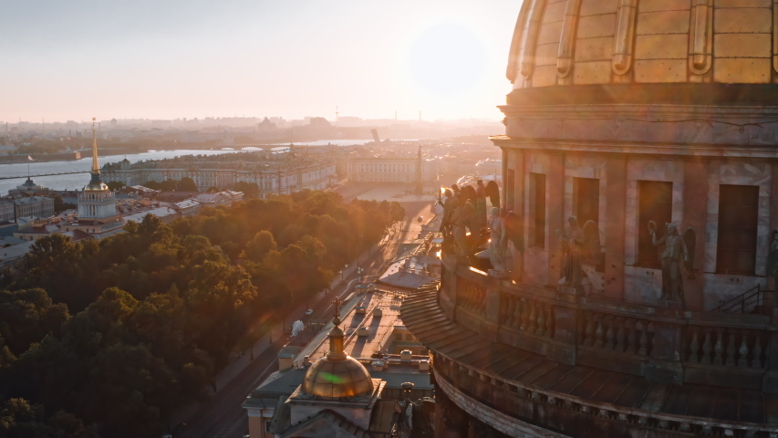 Sunny drone views of sculptures of angels on the colonnade of St. Isaac's Cathedral in Saint Petersburg, Russia | Shutterstock HD Video #1038449657