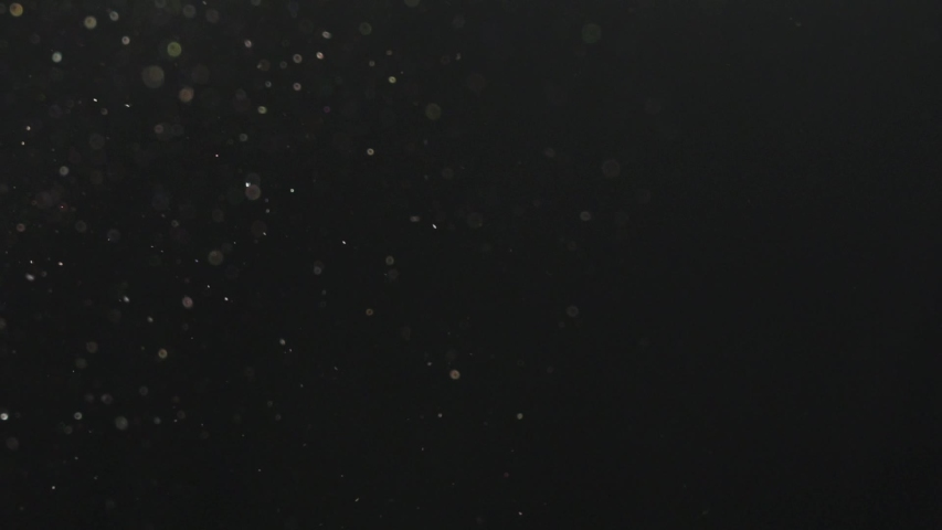 dust particles in slow motion #1038460292