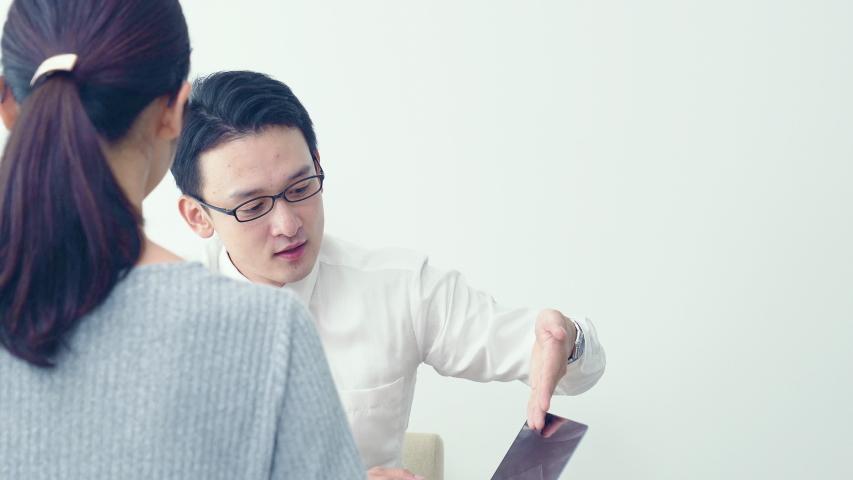 Young asian salesman explaining at a shop.   Shutterstock HD Video #1038462587