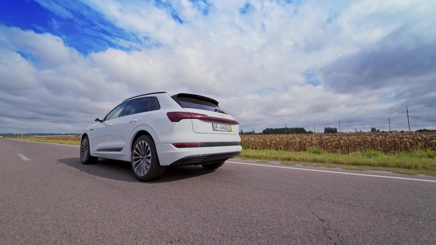 VINNITSA, UKRAINE - September 2019: White luxury car on road on the field background. Very fast driving of audi car on highway under beautiful sky at daylight.