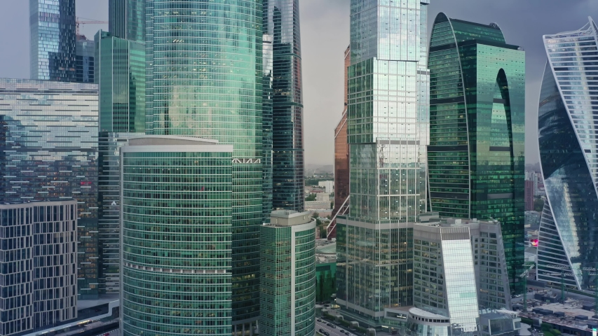 Aerial drone zoom in shot close up of Moscow City glass buildings. Smooth drone shot through Moscow Business Center skyscrapers