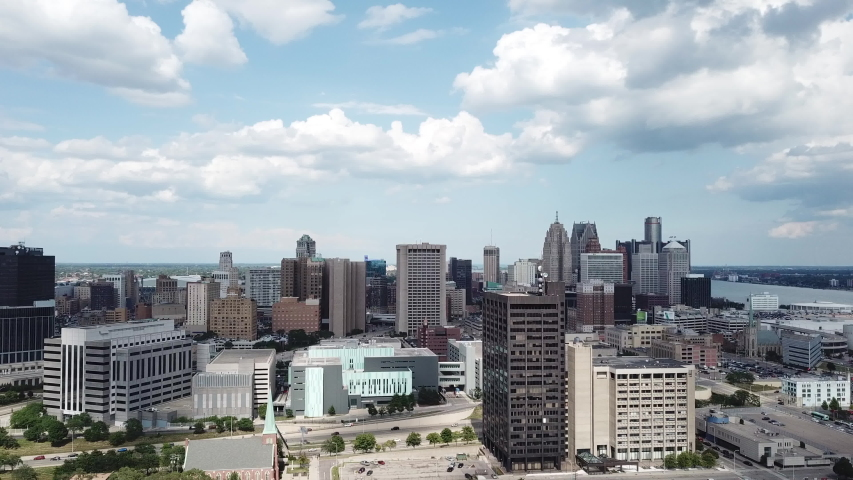 Aerial Drone Footage of Corktown Detroit. Detroit skyline and traffic visible on a beautiful sunny day